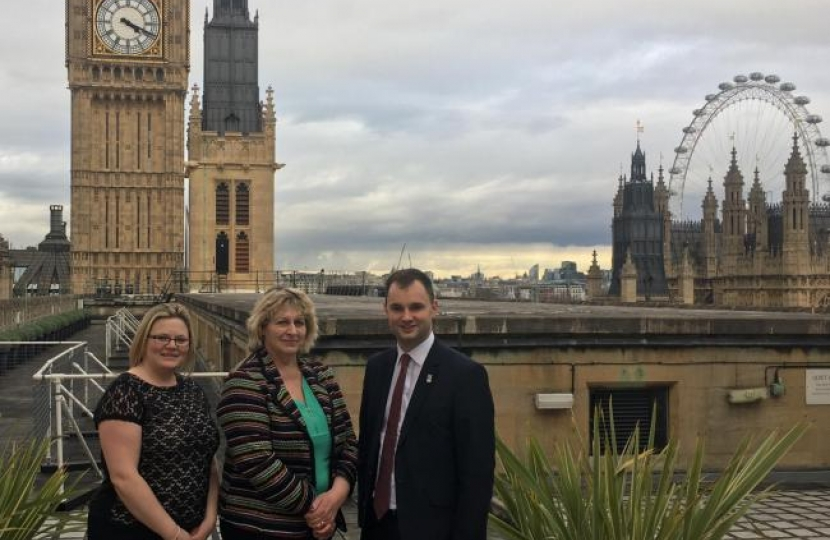 Luke with the Rose and Crown owners on the roof of Parliament